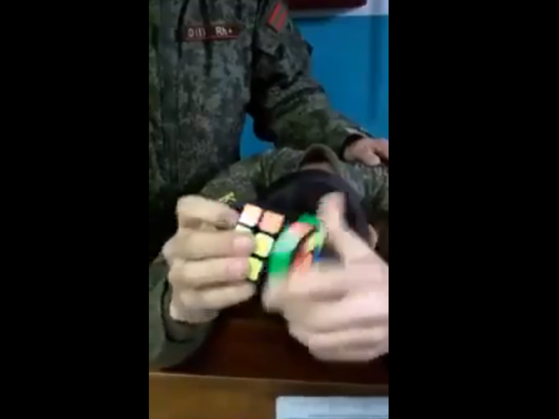 Russian Soldier Solves the Rubiks Cube With His Eyes Closed!