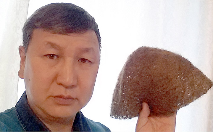 A Siberian Man Sells a Hat From Mammoth Fur: 10,000 Bucks And It's Yours!
