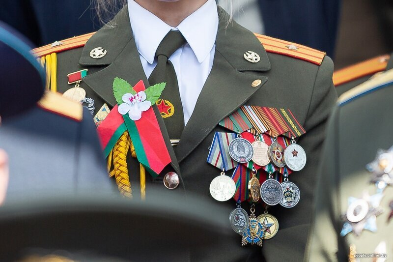 Girl From Belarus With Her Chest All in Medals