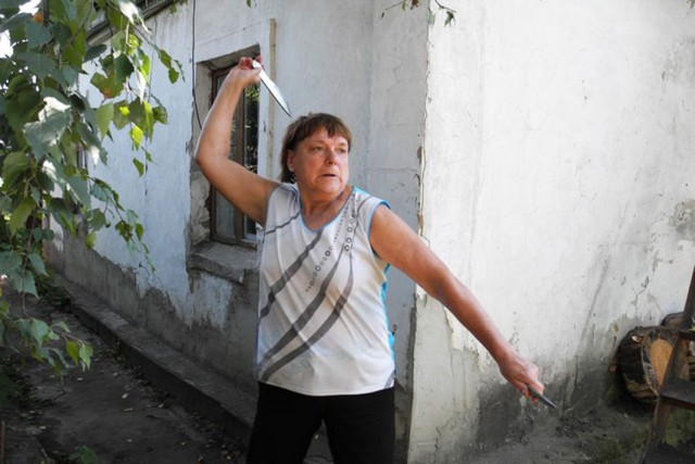 Old Russian Woman Who Has No Rivals in Throwing Knives
