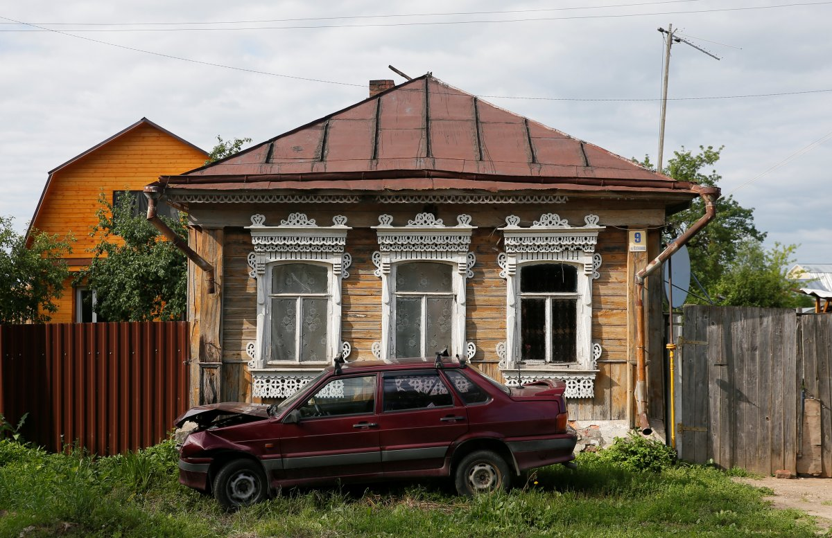 Monuments of Old Russian Wooden Architecture: Plastic Windows, Satellite Dishes, Devastation